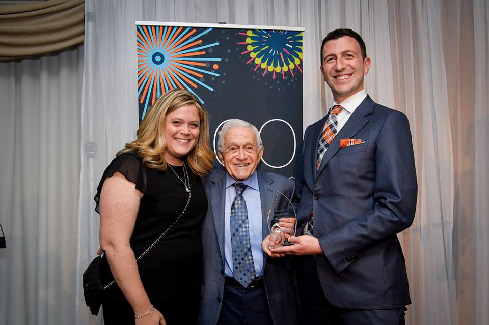 Jack J. Fattal (standing on the right, with Karina and Arthur Roskies) receives the Jon Roskies Award for New Leadership at the 2017 Jewish Leadership Awards.